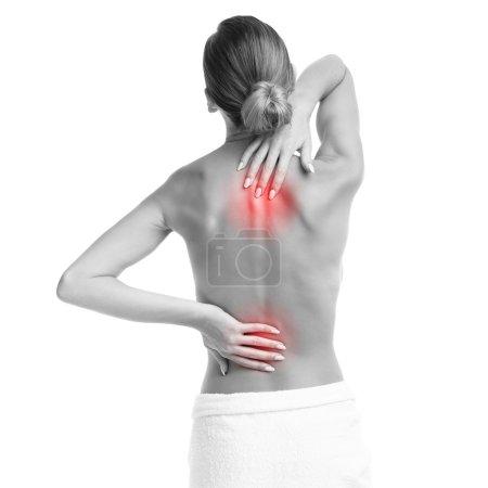 Photo pour Photo d'une femme avec mal de dos sur fond blanc - image libre de droit