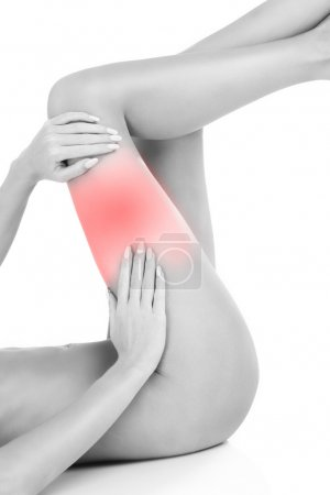 Photo for Woman suffering from thigh pain over white background - Royalty Free Image