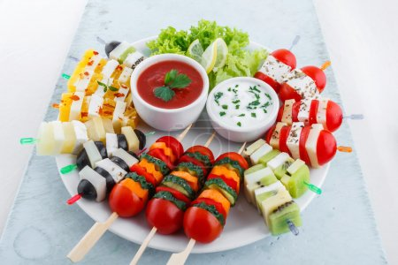 Photo for Assortment of fruit and vegetable appetizer with dips - Royalty Free Image