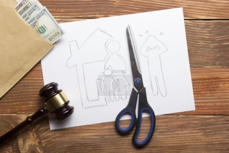 Family law concept. Divorce section of the property by legal means. Scissors cutting paper