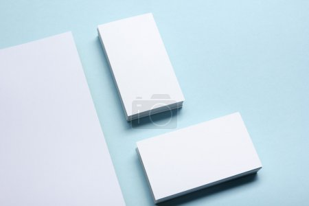 Business card blank over office table. Corporate stationery branding mock-up