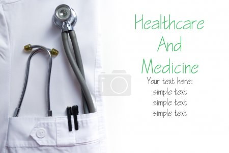 Doctor lab white coat pocket with pen, stethoscope, close-up shot isolated on a white background. Copy space