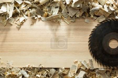 Carpenter tools on wooden table with sawdust. Carpenter workplace top view