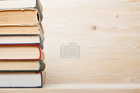 Photo for Stack of colorful books on wooden table. Back to school. Copy space - Royalty Free Image