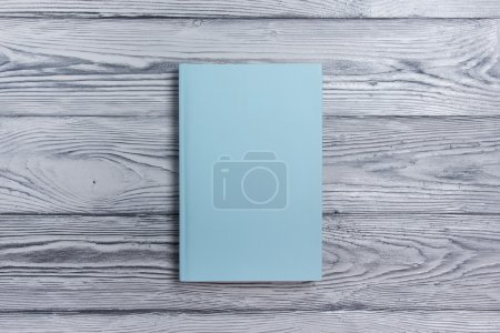 Photo for Blank book cover on textured wood background. Copy space - Royalty Free Image