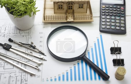 Model house, construction plan for house building, magnifying glass, divider compass. calculator. Real Estate Concept. Top view.