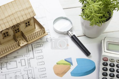 Model house, construction plan for house building, magnifying glass compass. calculator. Real Estate Concept. Top view.