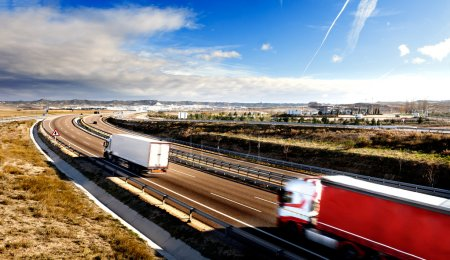 Photo for International forwarding.Trucks carrying goods and highway - Royalty Free Image
