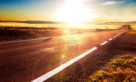 Photo for Adventures and road trips.Sunlight and road lines.Road and fields - Royalty Free Image