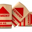 Front view of bags of cement on white background (...