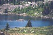 Mountain lake with pine trees