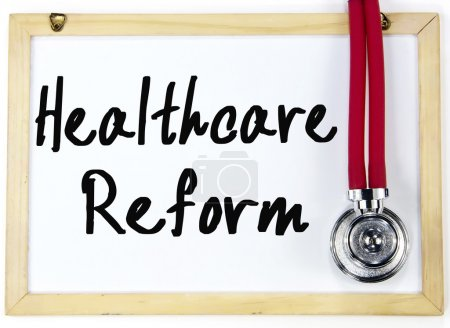 healthcare reform text write on blackboard