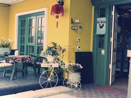 Retro flower pot shape bike at a coffee shop.