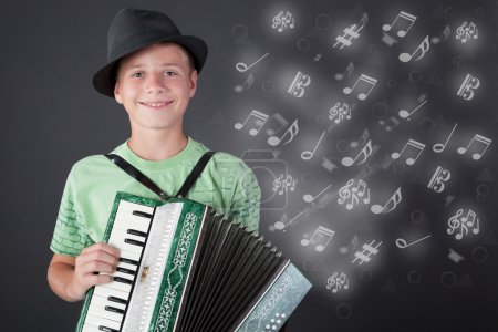 little musician with hat playing the accordion