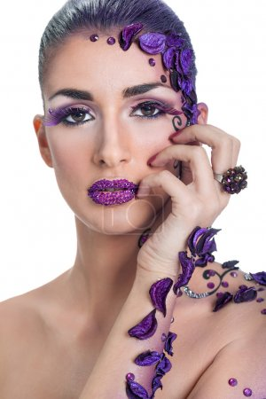 Young woman with beautiful hair style and art abstract make-up
