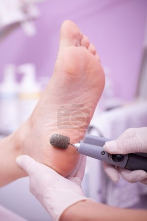 Foot care treatment ,woman at the beautician for pedicure
