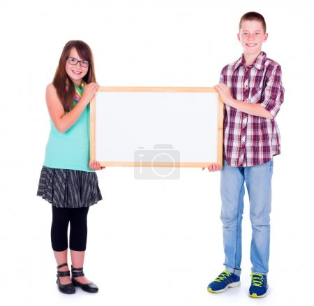 Boy and girl holding an empty advertising board