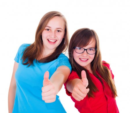 Teen girls showing thumbs up