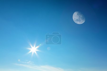 Photo for Moon and sun together on the daytime blue sky (Composite image). - Royalty Free Image