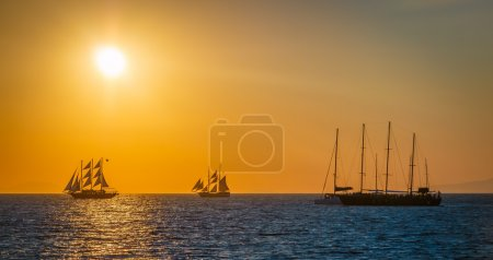 Sailing ships on the sea in sunset