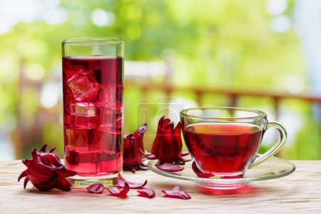 Cup of magenta hot hibiscus tea and the same cold drink