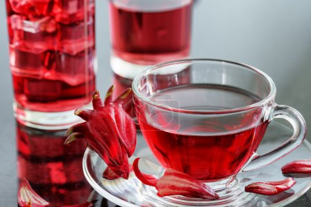 Cup of hibiscus tea (karkade, red sorrel) on table