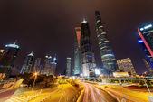 "Постер, картина, фотообои ""Night view of Century Avenue and skyscrapers in Shanghai, China"""