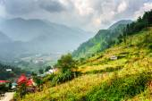 Scenic view of village houses and the Hoang Lien Mountains