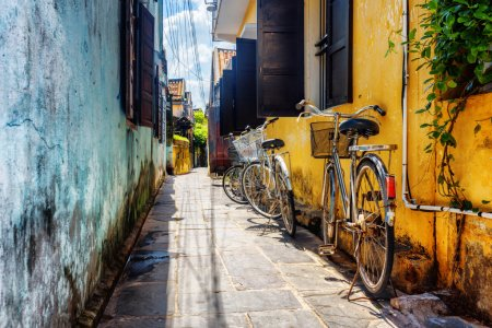 Bicycles parked near yellow wall, Hoi An Ancient Town