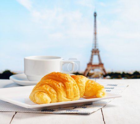 Cup of coffee and croissant in Paris