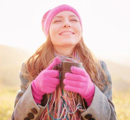 Young woman smiling enjoying the spring season