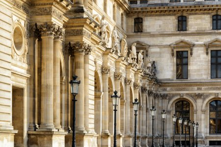 Columns and sculptures that adorn the facade of the Louvre in Pa