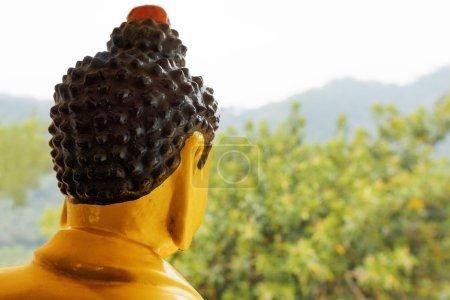 Buddha statue watches over surroundings of the Ten Thousand Budd