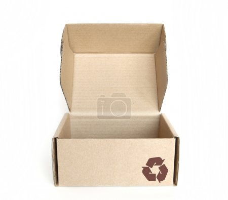 Empty cardboard box with recycle logo on white background