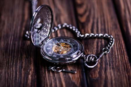 vintage pocket watch on wood