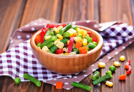 Mix vegetables in bowl