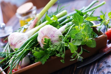 Garlic and green herbs