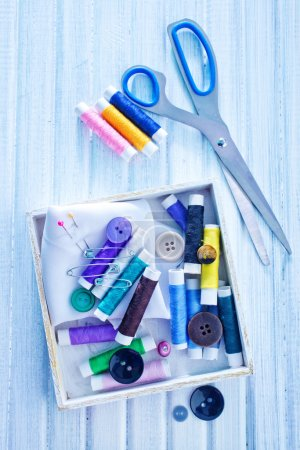 Scissors, bobbins with thread