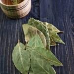 Laurel leaves on wooden table...