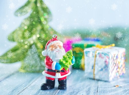 Photo for Christmas decoration and christmas tree on a table - Royalty Free Image