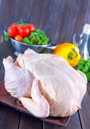 Raw chicken and fresh vegetables
