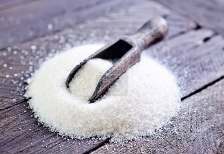 Heap of sugar on table