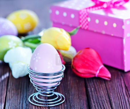 Photo for Easter background, easter eggs and flowers on a table - Royalty Free Image
