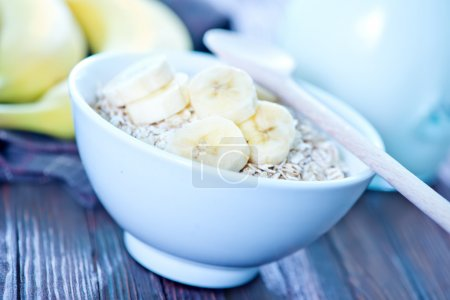 Photo for Raw oat flakes in the white bowl - Royalty Free Image
