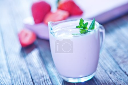 Strawberry yogurt in glass jug