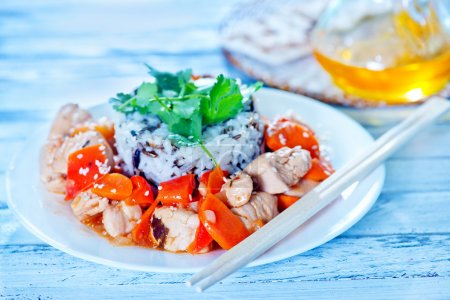 Boiled rice with fried chicken