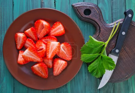 Sliced strawberry on plate