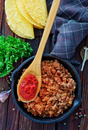 bowl of fried ground meat with tomatoes