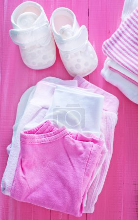 Baby clothes on the table