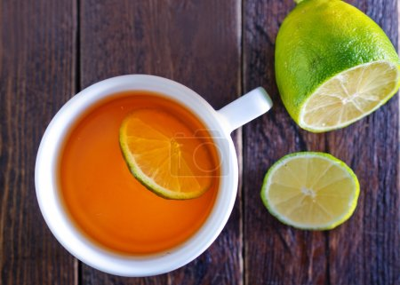 Tea with lemon in white cup